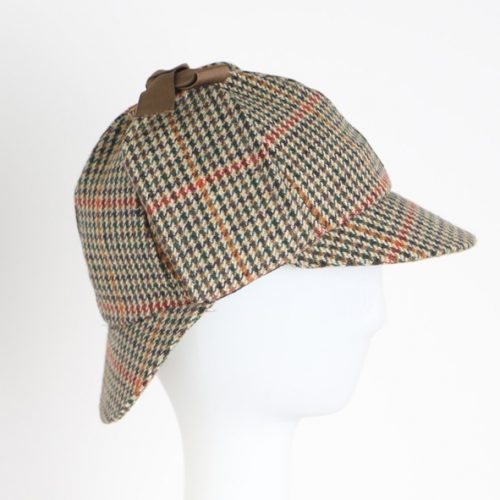 sherlocks-deerstalker-by-glencroft-classic-sherlock-holmes-style-hat-with-ear-flaps-tied-above-the-head-double-ended-visor-harris-tweed-sherlockshats.com